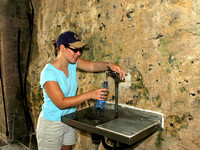Tammy filling her water bottle at Rosh Hanikra