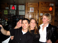 Eric and the girls at a bar