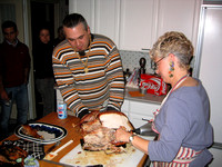 Chris helping Gail carve the turkey