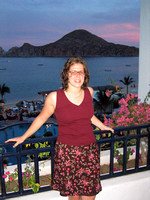 Tammy_on_balcony_with_sunset_2